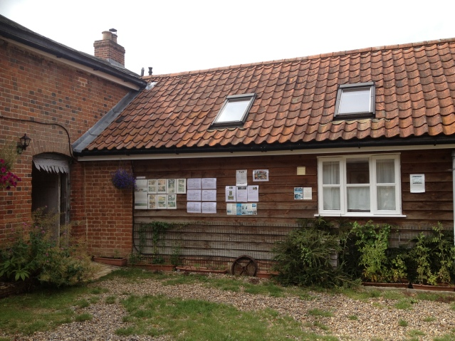 this is one of the other cottages. and there on the left is the walk-through, which leads to a communal garden and out into the fields
