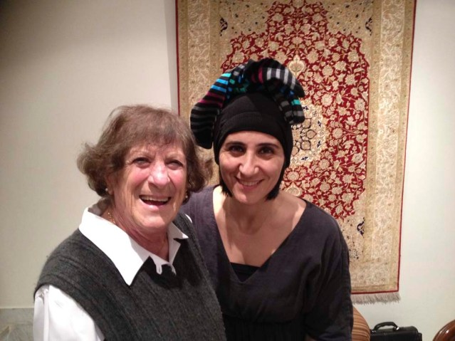 this is aunty ilham and me the day she gave me those very special tights. i was already wearing tights that day so figured they'd look great on my head. so technically, i did have headgear on last night, but on my legs. or is it the other way around?