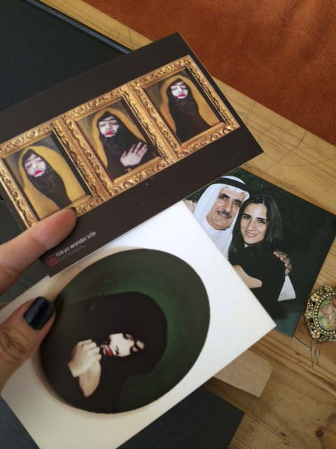 munira al qadiri's tragedy of self postcard and a photo of my father and me taken a decade ago