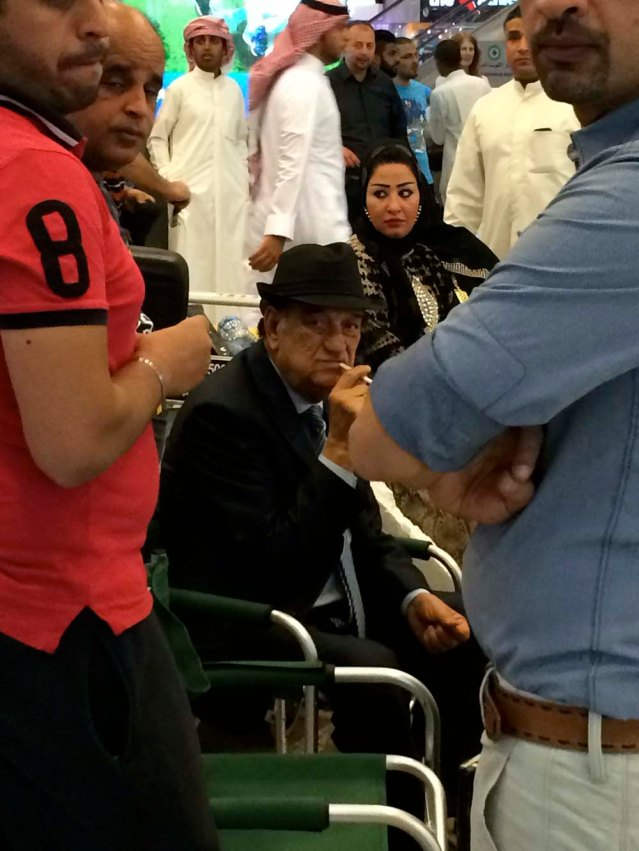 mayhem in kuwait airport. confetti, balloons being popped, bright lights...and this egyptian actor. they were filming a series. i don't think this guy's too happy he's being photographed by a crazy chick in black