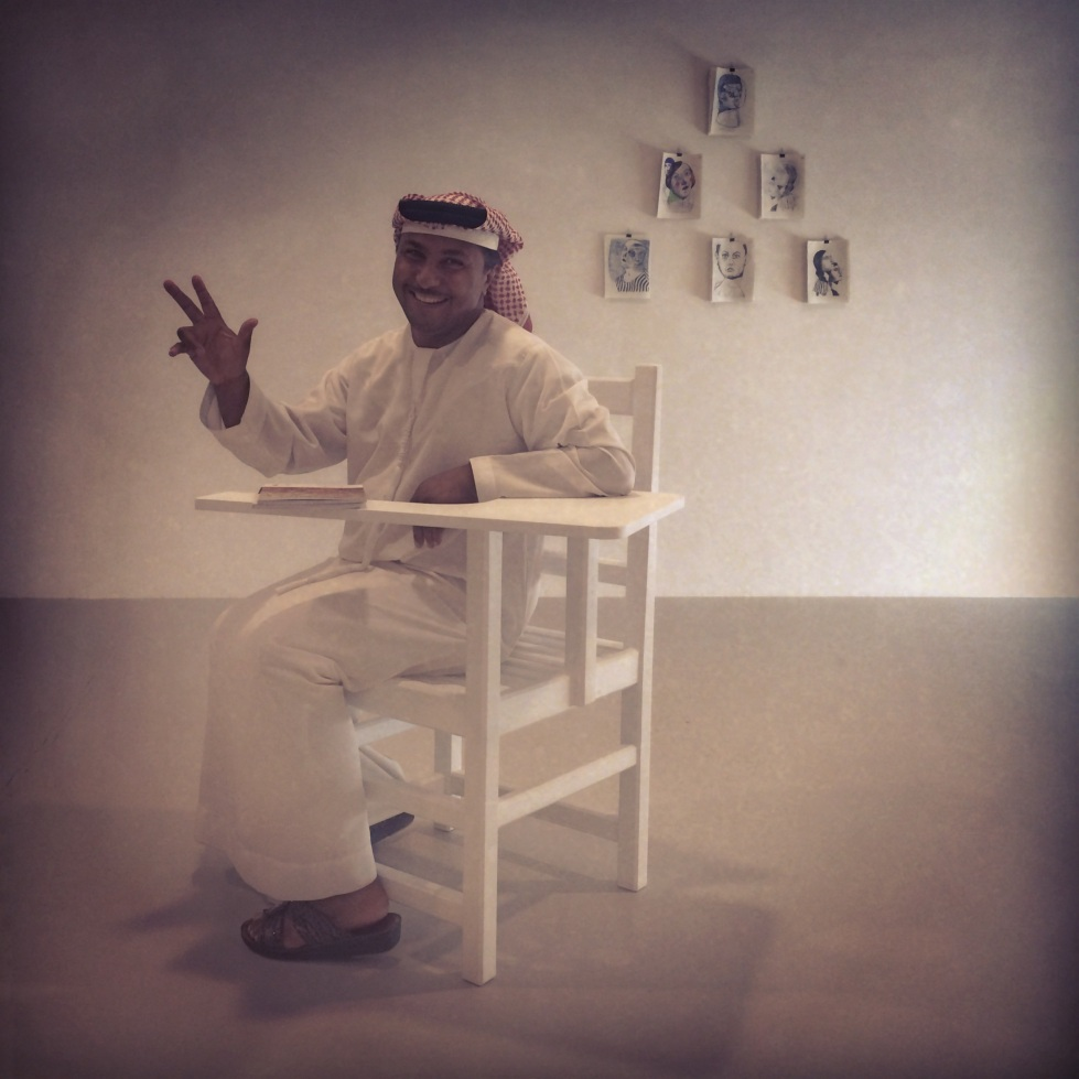 man in a chair. how delightful this man was. the qataris enjoyed my chair most