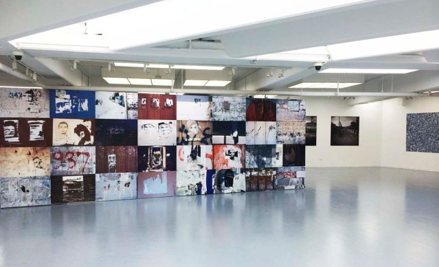 taysir batniji's untitled (gaza walls) is the first installation you see when you walk into the 'keep your eye on the wall' exhibition featuring photographers taysir batniji, rula halawani, raeda saadeh, steve sabella, and kai wiedenhöfer