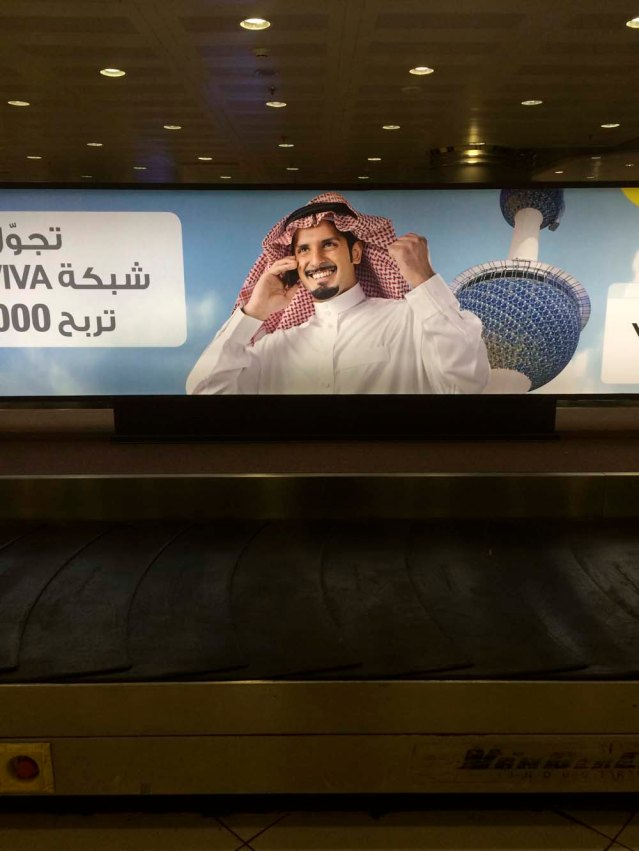 you may be wondering why this photo is relevant. well, a. it's a conveyor belt at the airport here in kuwait, and b. the guy in the ad looks uncannily like my brother
