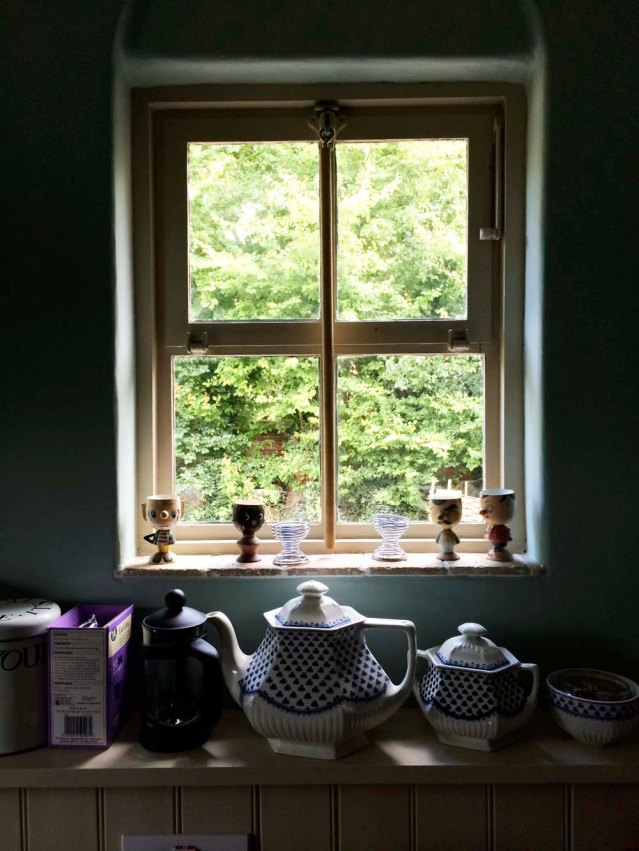 how could i when it was offset by all this charm? quirky egg holders on the window sill