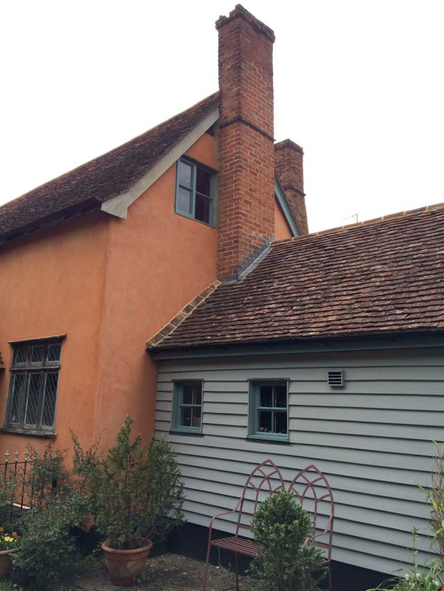 the side of the cottage. that window up there is the bedroom and the blue bit is the kitchen