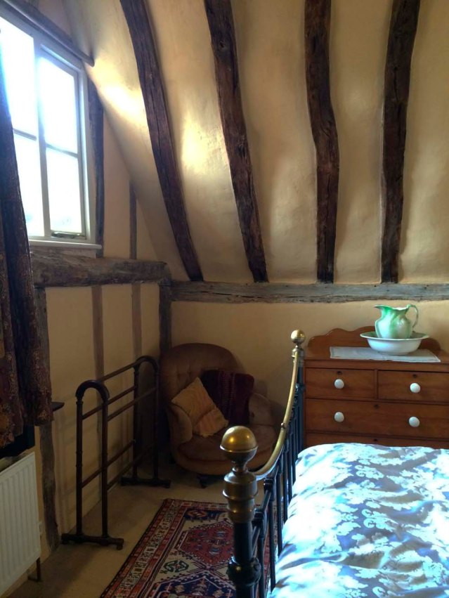 sunny in the daytime, i was a little scared to be here at night. and this is why i should never, ever visit one of these gorgeous cottages alone. oh! look at the chair in the corner. i fell in love with this chair, which looked like it had seen better days. but i'm like that; i find charm in battered old things