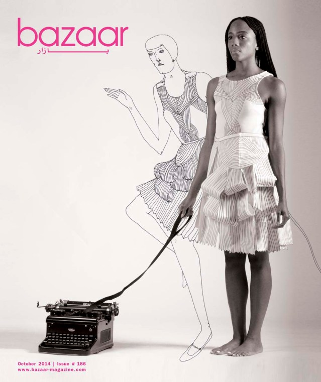 cover of october's bazaar magazine featuring dawnn karen, her pet typewriter, and eve