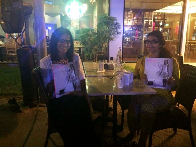 dinner with Maysaa at PQ with glasses and magazines. i finally got to see the hard copy of this month's bazaar