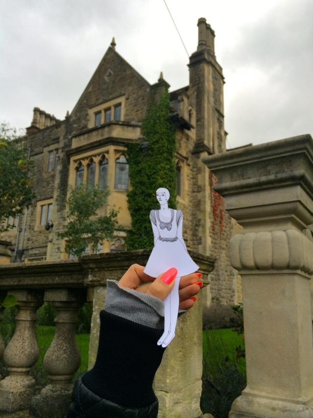 the fourth property: camilla lacey, or 'tom's house'. here eve poses outside this spooky, dragon-ridden mansion