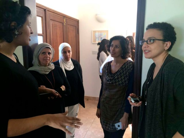 deema (left) explains her 'madeenah' city walks to an attentive huda, laila and farah at zeri crafts