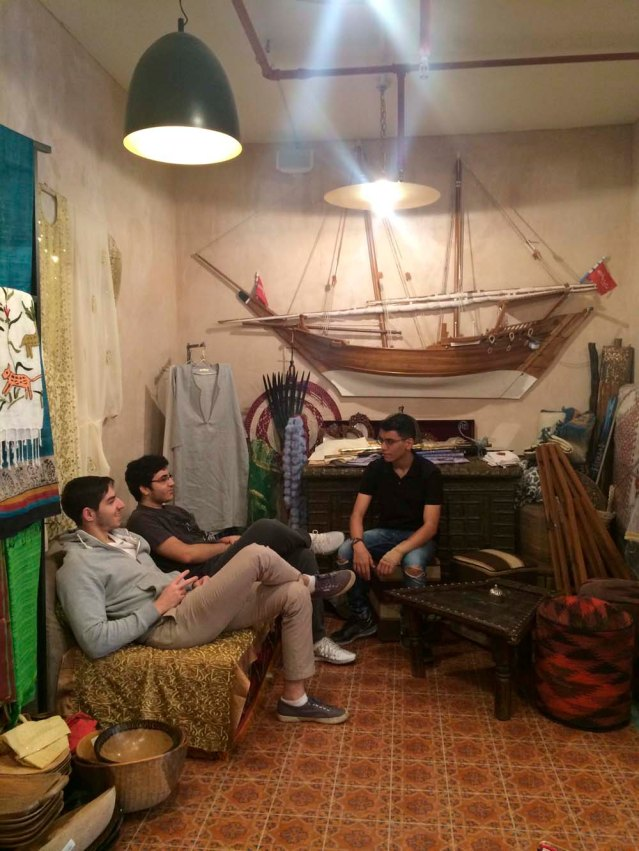 and back to the riff raff. omar, khaled and yousef chat among a dhow, chest and some ersatz swords