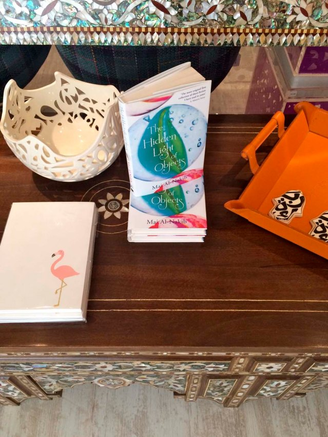 my dear friend mai al-nakib's book 'the hidden light of objects'. also an intricate ceramic piece and 'hands of fatima' by jordanian sculptor katia al-tal. and i love choux a la creme's quirky cards and notebooks, like the flamingo one here