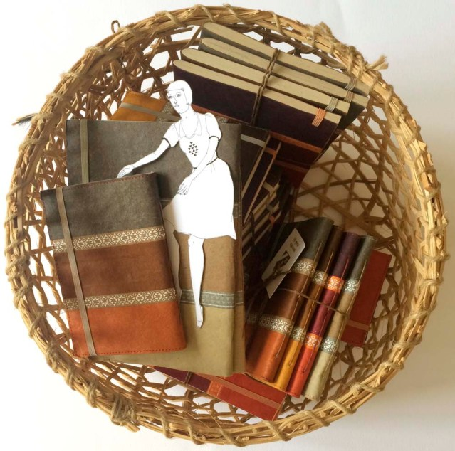 swimming in a basket of earth-toned notebooks is her favorite thing to do