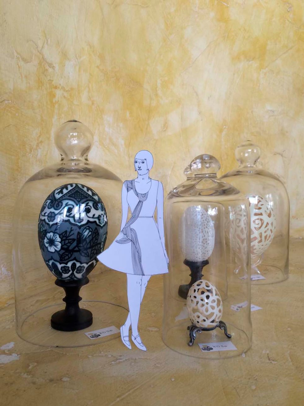 eve takes a stroll among reem al-nouri's carved eggs