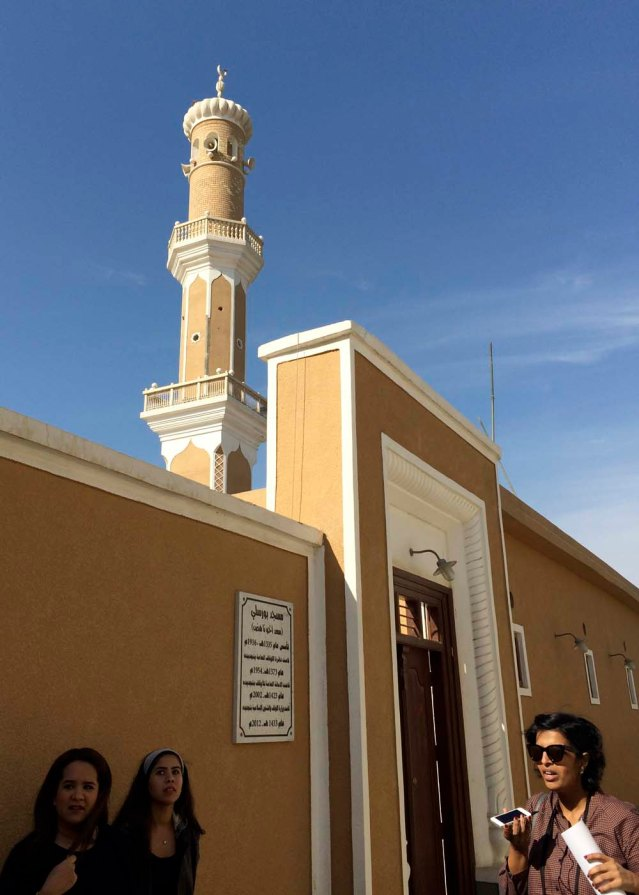 tour guide deema al-ghunaim in front of bourisly mosque, built in 1916
