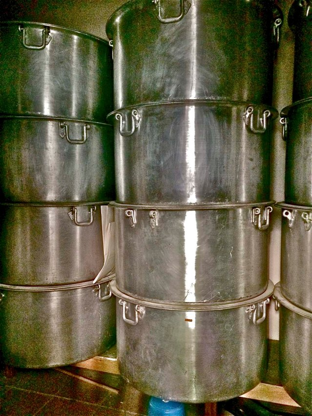 inside a storeroom are these massive pots. i see folks serving machboos and other rice dishes from these pots at ashoura and other festivals. these things are huge. humungous. i cannot express big
