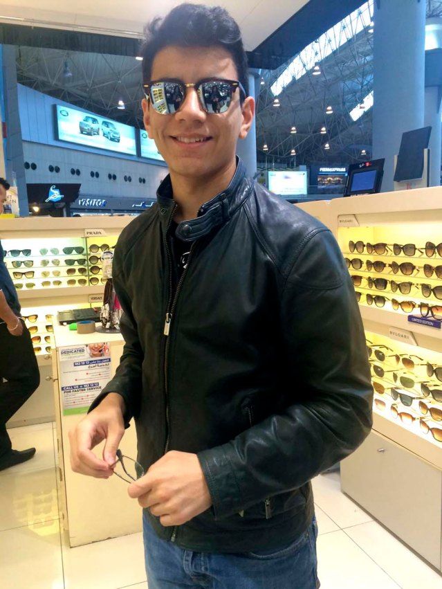 i was dropped off at the airport by my nephew tarek and my son yousef. it's so nice when roles are reversed and you feel like the little ones are now taking care of you. here yousef tries on a pair of aviators. joe cool