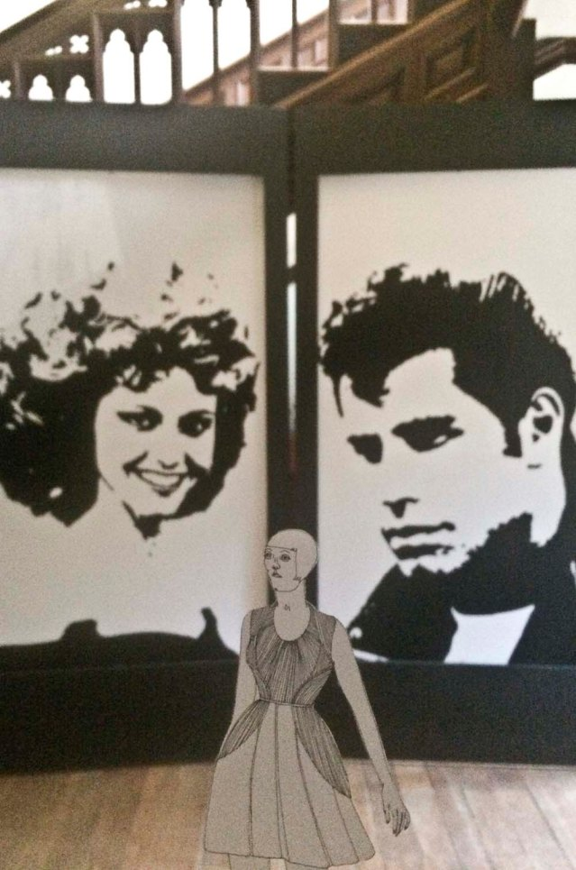 her favorite movie is grease. here she is with olivia and john, aka sandy and johnny