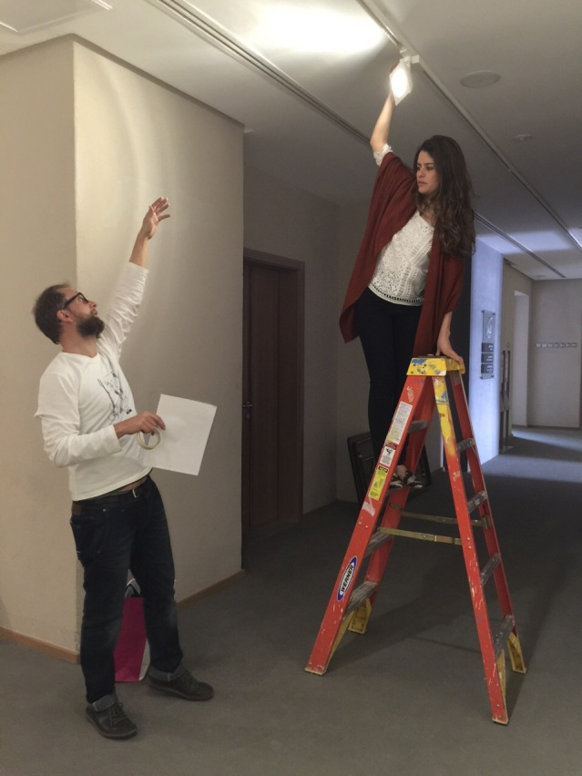 fixing the lights. don't fall, farah! photo by farida sultan