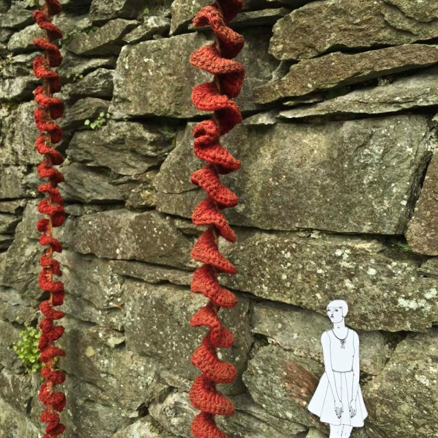 she finds hanging knit sculptures by dianne standen. she wishes she could knit, and decorate nature with her creations