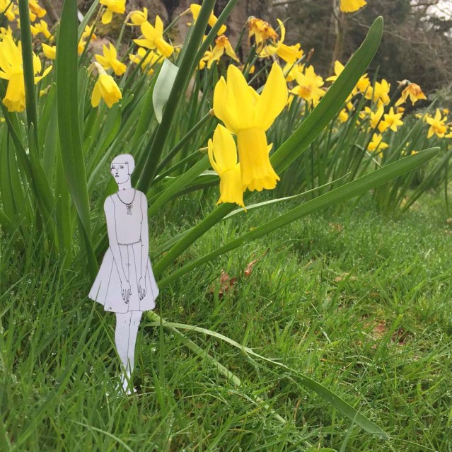 she speaks softly to daffodils