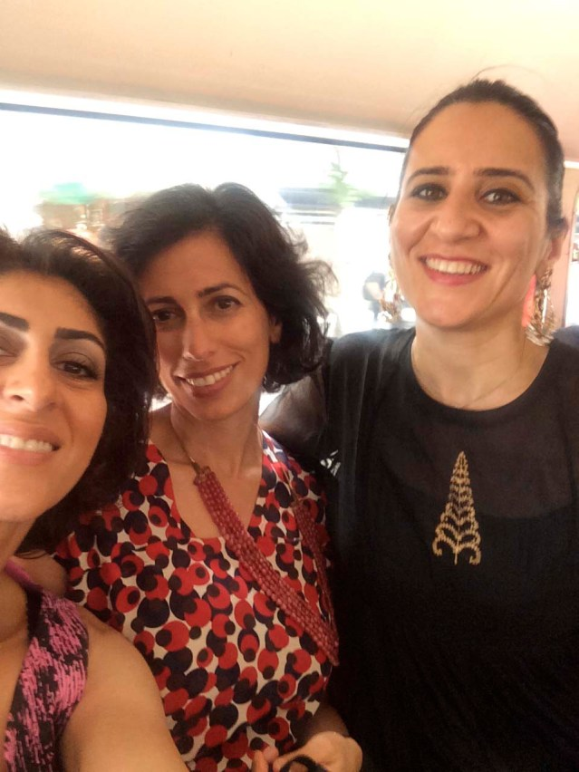 june 27 } wedding day. on the bus from the ceremony, which took place in the chelsea old town hall. my new friend razan, laila and me
