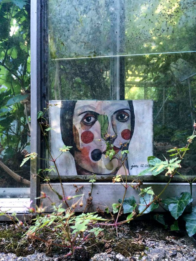 the third greenhouse is the emptiest and the most overgrown. this one resists leaving. she hides in between the panels but i finally manage to wrest her from the panes