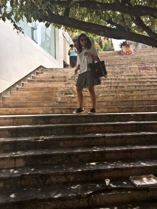 yasmine and the steps. i regret so much not bringing my traveling tap, even though it would have been a pain lugging it around in the heat