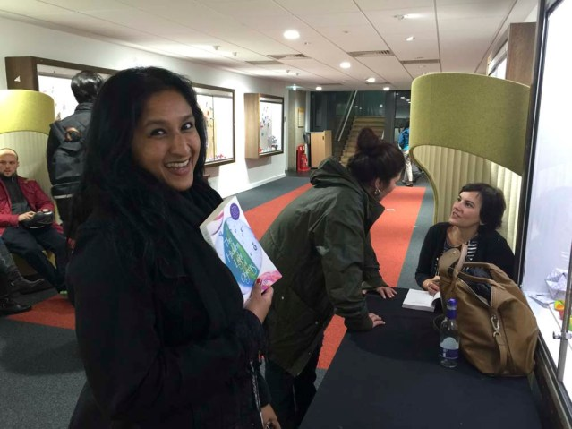 ayesha waits for her book to be signed as amira behbehani chats with mai