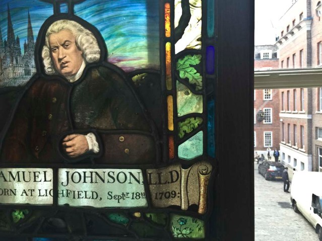 dr. johnson's strategic stained glass window allows him a great vantage point. he has two views: one onto gough square and the other into this alcove