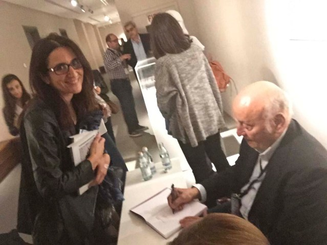 i lose my phone for a while so can't take any photos. luckily for me, laura's got hers. helmy el touni signs my copy of yasmine taan's book about his works