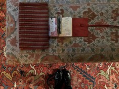See? Here, my laptop case mixes wonderfully with the ottoman and rug. And of course my Hope House Press journal.
