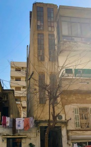 March 5 I walk to the printer's with Laura. I love Beirut's old buildings.